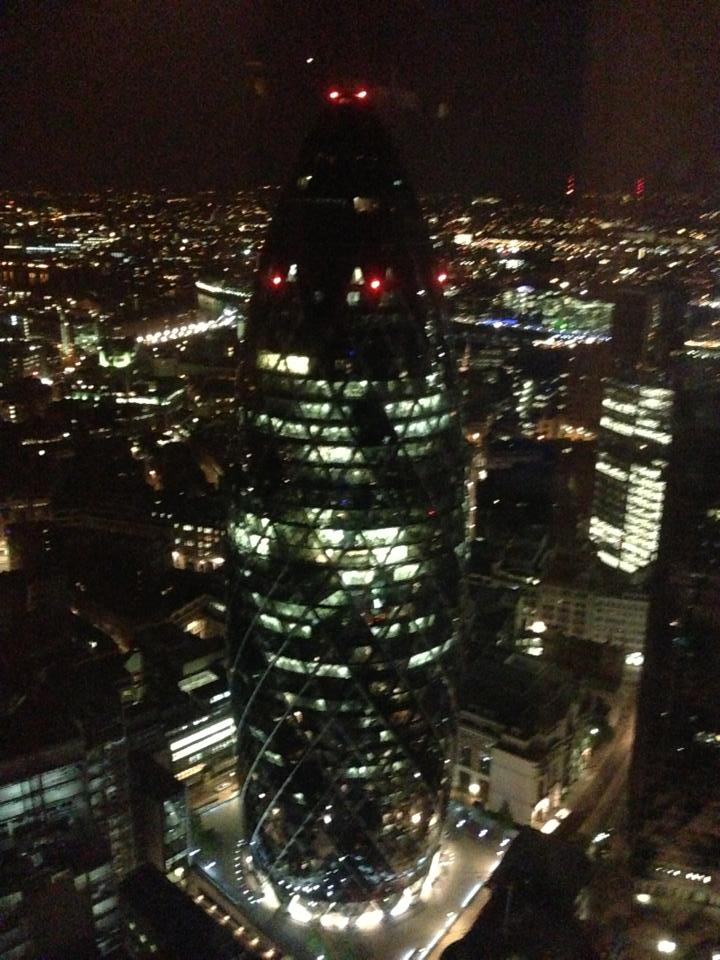 The Gherkin lit up at night