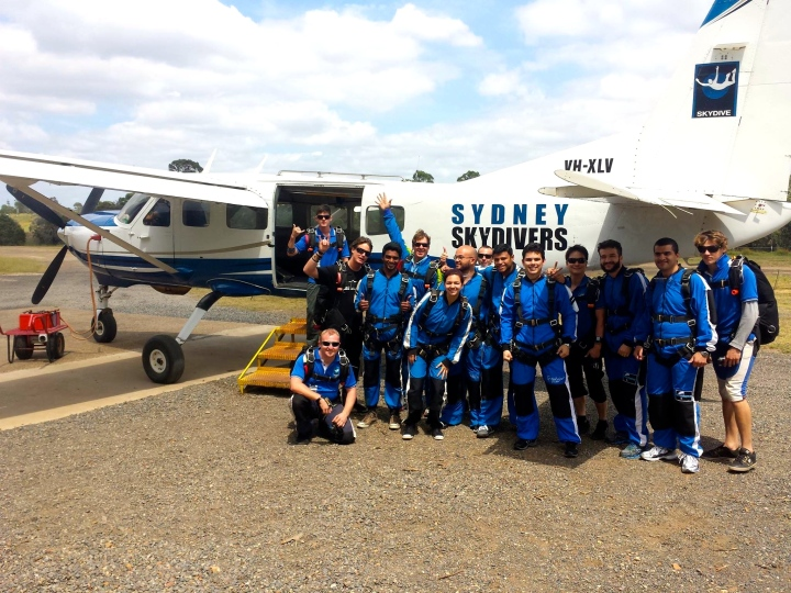 The group and their instructors about to jump on the plane