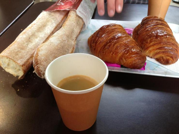 Enjoying Paris as you should. With coffee, bread, croissants, good friends and locals.